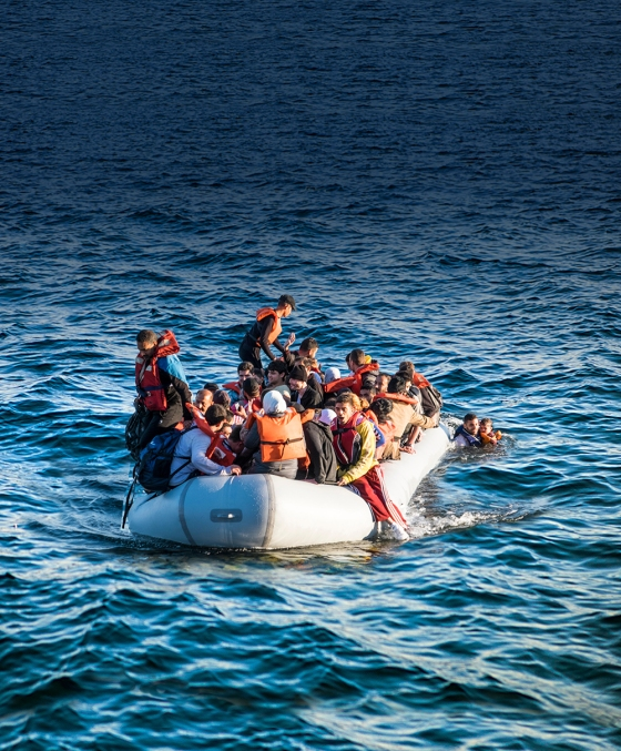 Syrian refugees cross from Turkey to land on a beach on the Greek island of Lesvos. Image shot 06/2015. Exact date unknown.